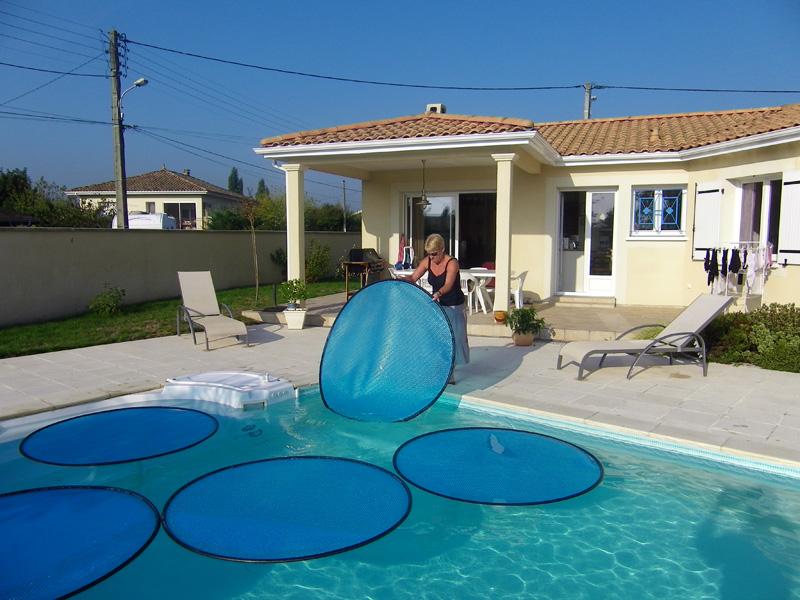 Chauffage piscine bache a bulle id e chauffage for Fabriquer un enrouleur de bache piscine