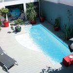 Cacher une pompe à chaleur piscine